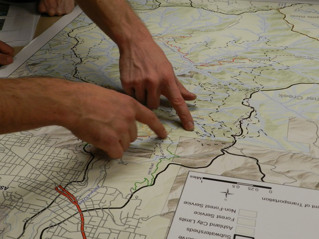 Two mountain bikers examine the new trails proposed for the Ashland watershed.