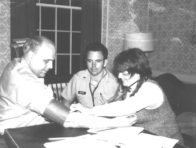 Dr. Burgess Record, center, works with a nurse in 1974 to check a patient's blood pressure. At the time, blood pressure checks were a rare occurrence in rural Maine. Record and his peers helped to reshape the health culture in Franklin County, Maine, over the course of more than 40 years.