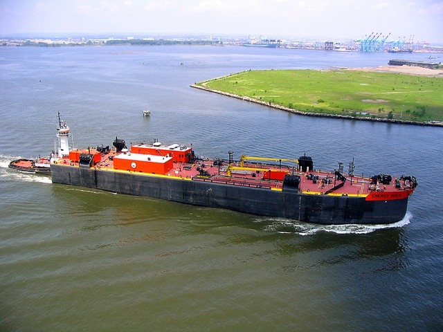 An oil barge. A new report by the non-partisan Congressional Research Service concludes that a shift in transport of oil to barges and ships raises many safety concerns.