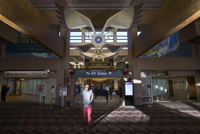 Eugene airport completes major passenger terminal renovations news eugene airport administration intern garrett ross walks past the entrance to the recently remodeled screening area freerunsca Image collections