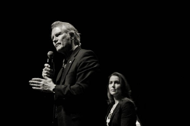 Former Oregon Gov. John Kitzhaber and First Lady Cylvia Hayes on-stage at the Tower Theatre in Bend.