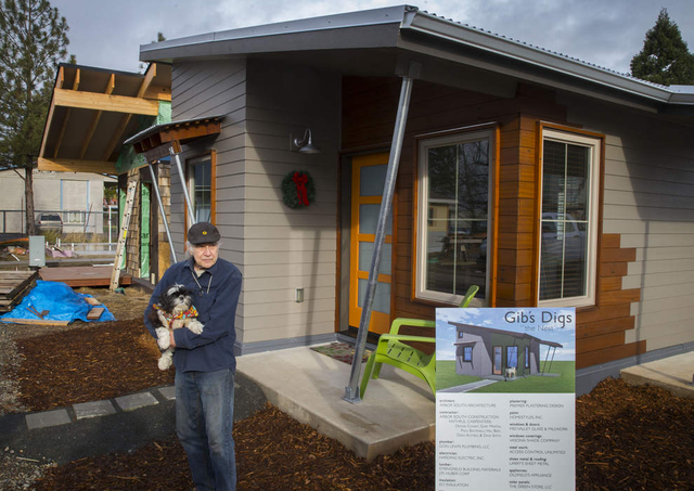Gib Hayes and his dog, Sadie, stand outside their new tiny house in Emerald Village Eugene, which aims to provide a bridge for homeless people into conventional housing.