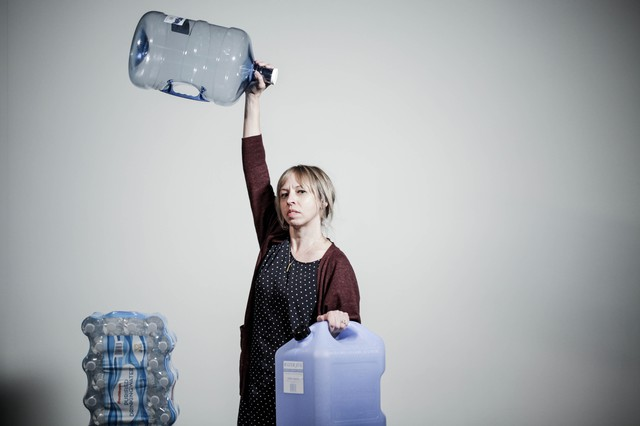 Digital producer Ann McGarry holds her 15 gallons of water like a true preparation champion.