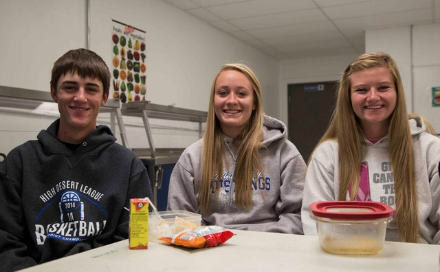 "Jordan Valley high school students Nick Eiguren, Andi Warn and Jaci Larsen bring their lunches from home most days. They say they don't miss the lunch program. ""I don't think kids are that bummed out about it, actually,"" says Warn."