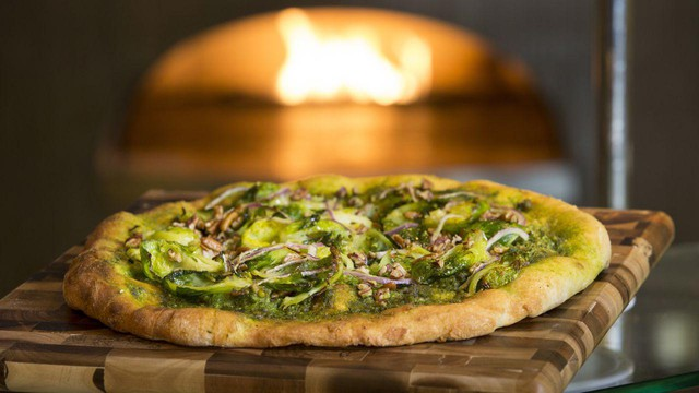This pizza features a parsley-pecan pesto instead of cheese, which is a higher-carbon food because of methane emissions released by dairy cows. It also features wheat, which is a crop that may have to be grown farther north as its current growing regions are affected by climate change.