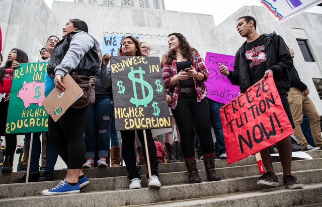 Students from around the state gathered outside the State Capital Building on Thursday, Feb. 12, 2015 to rally for an increase in public spending toward higher education.