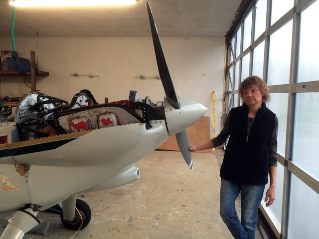 Mary Rosenblum, president of the Oregon Pilots Association, with her plane in her garage near Canby, Oregon. Rosenblum doesn't like the idea of leaded fuel, still used by many small aircraft, but she says alternatives are hard to find.