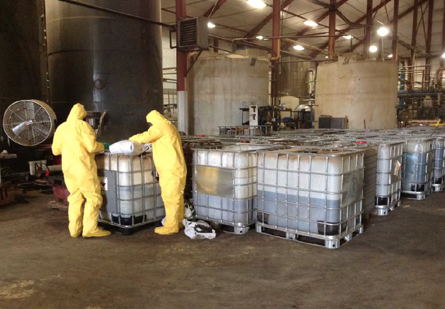 This photo obtained by the Columbia Riverkeeper through a records request to the U.S. Environmental Protection Agency shows workers inside the TransMessis Columbia Plateau biofuels plant in Odessa, Washington. After being abandoned in 2014, the plant required more than $400,000 worth of environmental cleanup.
