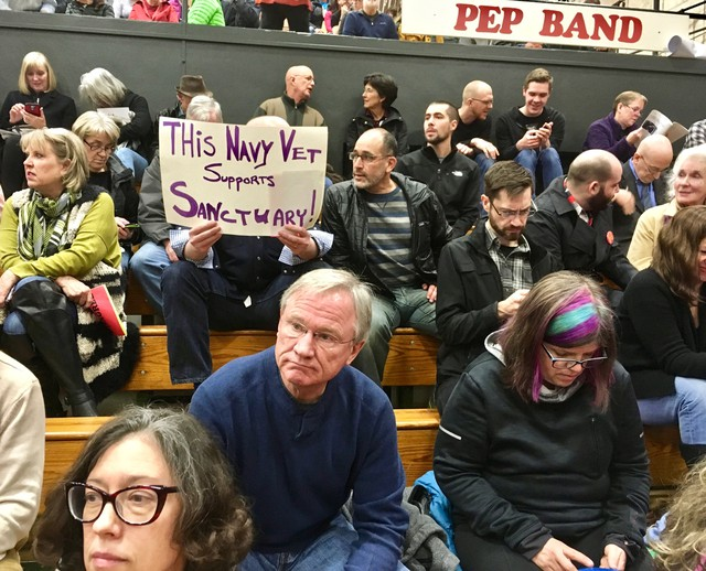 """Nathan Isaacs from Portland's St. Johns neighborhood said he was at a town hallrepresenting issues including sanctuary and immigration. He wants Ron Wyden """"to put his job on the line so our neighbors are safe and not ripped out of their homes by Trump deportation forces."""""""