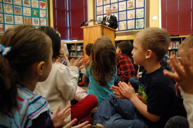 Kindergartners watch as the governor makes his speech.