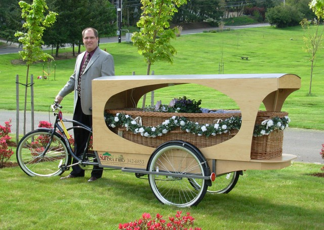 Wade Lind of Sunset Hills Funeral Home offers a natural burial package that includes a basket-like bamboo casket and a ride on a tricycle hearse for $3,500.