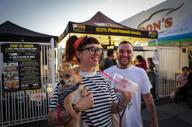 Nicole Georges and Rocco Kayiatos in front of Cena Vegan, a vegan pop-up in Highland Park, California.
