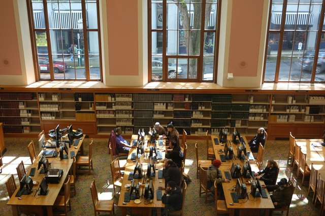 The downstairs reading room at the main branch of the Multnomah County Library, as seen from the stairwell.