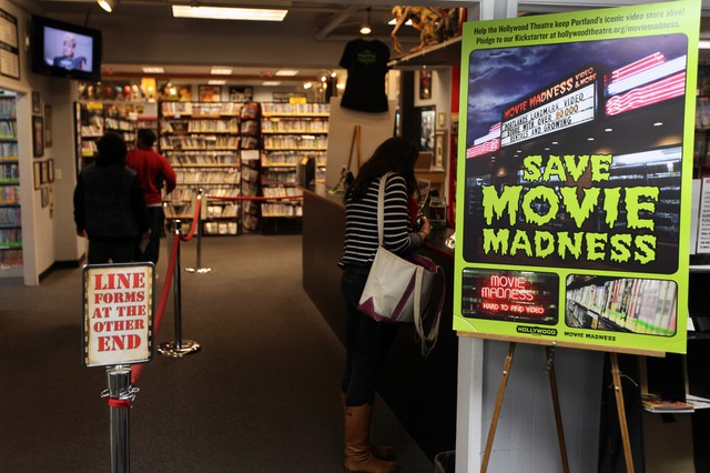 Save Movie Madness signs hang all over Movie Madness, as well as on the Hollywood's marquee.