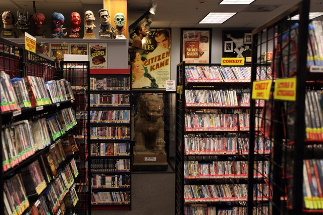 "Movie Madness's maze of aisles is stuffed with more than 84,000 films of all stripes, as well as film memorabilia like the Fu Dog Stature from the Xanadu set in ""Citizen Kane."""