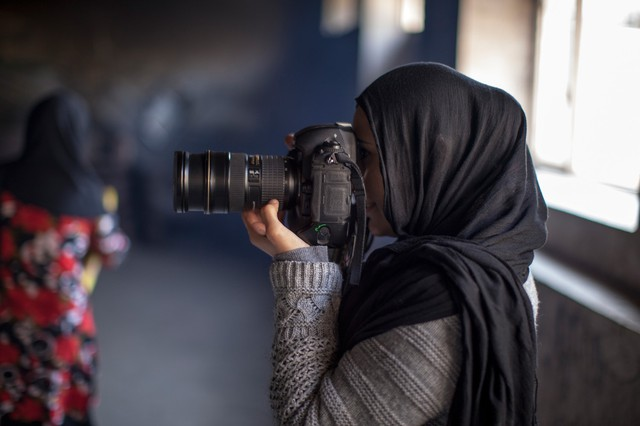 """Afghan photographer Farzana Wahidy is featured in the film """"Frame By Frame."""""""