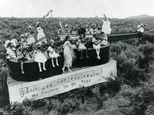 On the Fourth of July, children rode through town on a violin-shaped float.