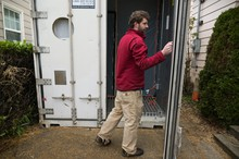 Ryan Bubriski opens a shipping container that would soon house most of the growing operation of the Portland Mushroom Company, multiplying their production of oyster mushrooms by a factor of four. The one-time refrigerated container was retrofitted with an electrical panel and air exchanger.