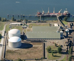 An aerial view of J.R. Simplot Company's Rivergate Terminal in North Portland shows two large tanks used to hold anhydrous ammonia. Simplot struck a deal with CF Industries to use the facility for its growing export markets in Asia.