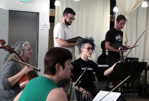 Members of the ensemble the Cult of Orpheus in rehearsal.