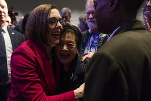 Kate Brown hugs a supporter at the Democratic Party of Oregon 2018 election party on Nov. 6, 2018 in Portland, Ore.