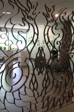 An elaborately worked gate inside the Hoffman Gallery at Oregon College of Art and Craft.