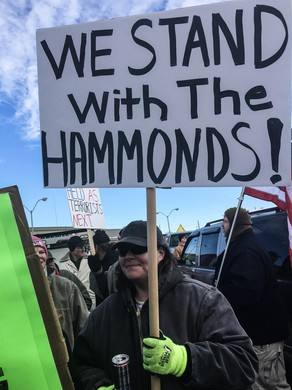 Protesters object to the sentencing of Oregon ranchers Dwight and Steven Hammond during a rally in Burns, Oregon, on June 2, 2016.