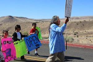 Delson Suppah, Sr. leads three young tribal members in a march at Kah-Nee-Ta.