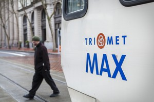 The TriMet Max picks up passengers in downtown Portland.