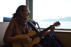 Julienne Battalia, one of the pipeline protesters who traveled from Washington to British Columbia to join a march opposing expanding oil transport through the Salish Sea. She and others in her group sang about the sea, which is shared by Washington and BC, while taking a ferry ride to Victoria.