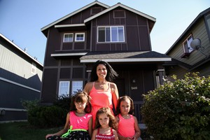 Alaina Campos and three of her daughters outside their new home. They secured a rental in Redmond after months of searching.