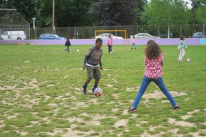 """Fourth graders at Grout Elementary in Southeast Portland do soccer drills as part of a program called """"Playworks."""" It was partially funded by a grant from the Portland schools foundation, All Hands Raised."""