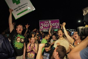 The crowd celebrates as the clock strikes 12 and marijuana officially became legalized in Oregon.