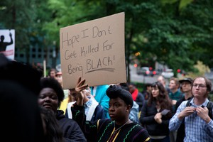 """People show their anger at Thursday's """"This Can't Be Justice"""" solidarity protest in wake of the killings of Philando Castille and Alton Sterling."""