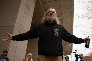"""An occupation supporter shouts """"Free the Hammonds"""" outside the federal courthouse in Portland. The 41-day occupation of the Malheur National Wildlife Refuge was partly driven by the resentencing of Harney County ranchers Dwight and Steven Hammond."""