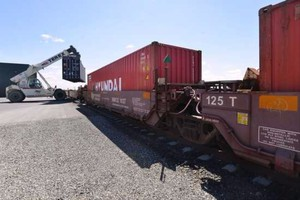 A shipping container is offloaded from a railcar at one of the railroad spurs in May 2015 at the Port of Morrow.