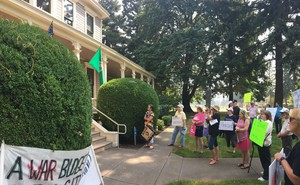 A rally held Tuesday outside of U.S. Rep. Jaime Herrera Beutler's Vancouver Office. Protesters from the political group Indivisible are demanding Herrera Beutler hold an in-person town hall.