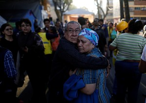 People wait along the street after a tremor was felt in Mexico City, Mexico February 16, 2018.