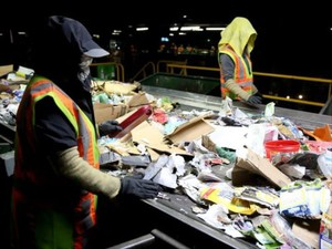Recycling sorters pull non-recyclables off a conveyer belt at Garten Services in Salem on Thursday, Jan. 11, 2018.