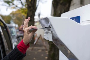 A voter drops off a ballot at a Multnomah County dropbox in November 2016.