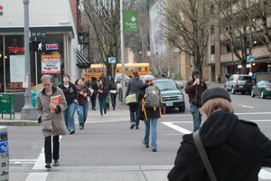 People cross Portland's SW 6th Avenue on Feb. 15, 2012, in this file photo.
