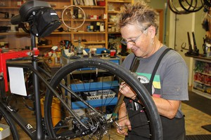 Bike mechanic Barb Bohm-Becker hopes Oregon's $15 new bicycle tax will diffuse claims that cyclists don't pay their share for infrastructure.