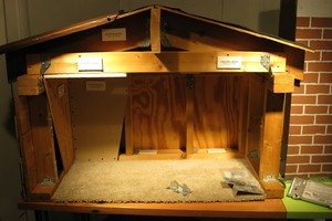A model of a home demonstrates earthquake resistant modifications.
