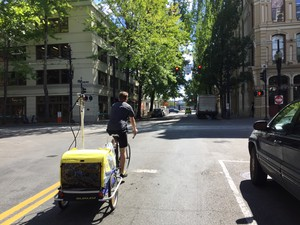 Portland State University graduate research assistant Philip Orlando tests for diesel emissions in downtown Portland using a bike trailer full of measuring devices.