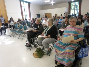 About 100 people converged on the St. Johns Community Center Saturday to talk about how best to spend tax increment funding on affordable housing.