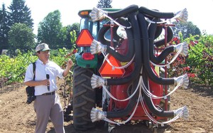 Heping Zhu, agricultural engineer for the U.S. Department of Agriculture, explains the computer system inside a smart pesticide sprayer.