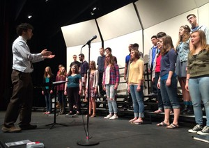 Ethan Chessin conducting the choir