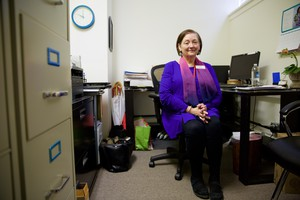 Rebekah Albert, executive director of Rose Haven, a Portland day shelter for women and children, inside her office in Northwest Portland.