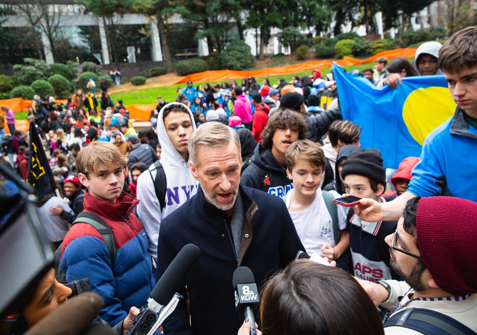 Mayor Ted Wheeler received the demands of the student activists after they marched toTerry Shrunk Plaza across from City Hall.
