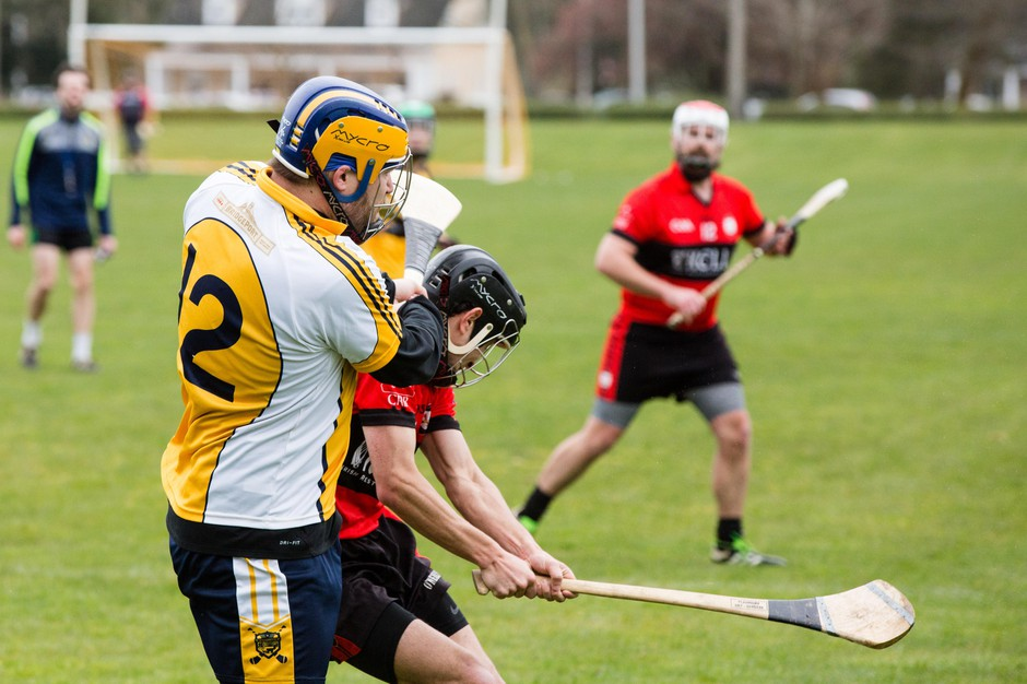 Duck! David Dodson smacks a ball out from goal during the 2018 season-opening hurling tournament in Tacoma.